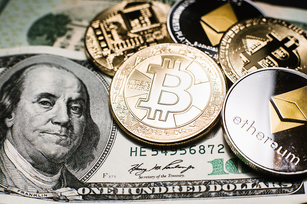 Bitcoin (BTC) and Ethereum (ETH) cryptocurrencies (crypto currency) are digital money with decentralized ledger. Gold bitcoin and silver ethereum coins on the one hundred dollar bill
