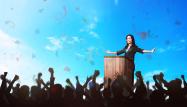 Successful asian business woman giving a speech in front of the people. Business concept