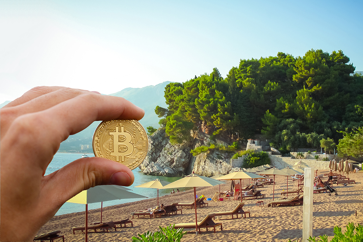 Hand holding golden bitcoin virtual money on golden sand in background sea concept freelance stock exchange